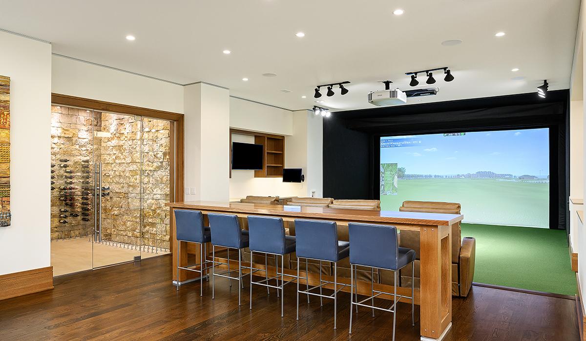 Prairie-Style Contemporary Golf simulator and wine room